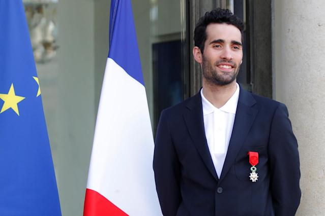 France's five-time Olympic champion Martin Fourcade poses after he was awarded Officier of the Legion of Honour (Legion d'honneur) during an award ceremony gathering French athletes that competed in the 2018 Pyeongchang Olympics winter Games, at the Elysee Palace in Paris, France, April 13, 2018. Reuters/Charles Platiau