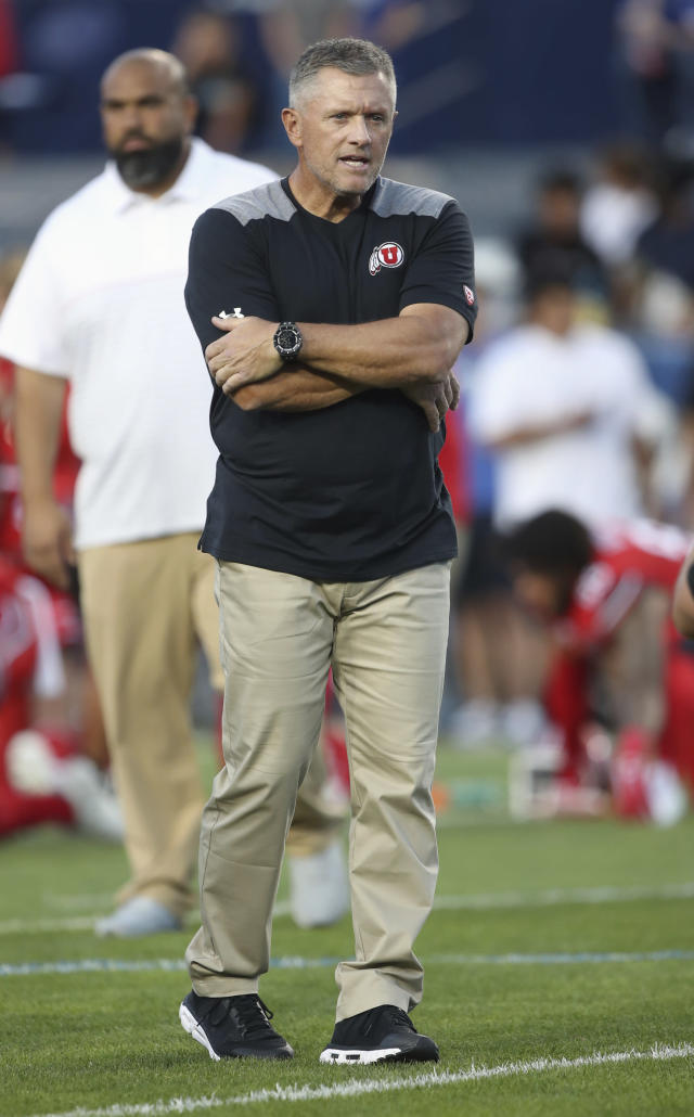 Utah coach Kyle Whittingham watches his team warm up for an NCAA college football game against BYU, Thursday, Aug. 29, 2019, in Provo, Utah. (AP Photo/George Frey)