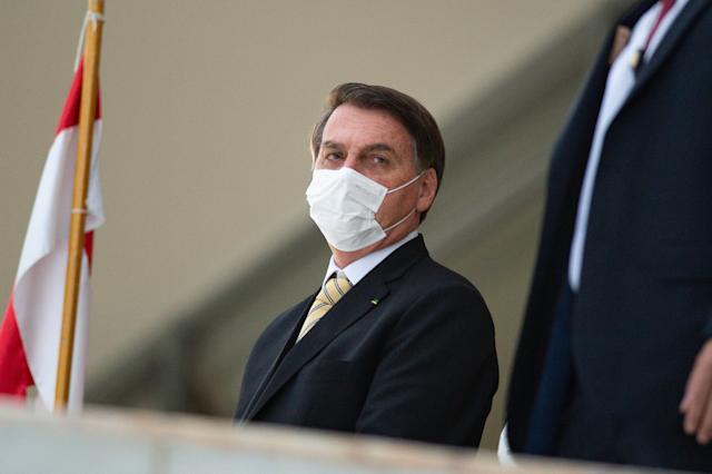 BRASILIA, BRAZIL - MAY 15: The President of Brazil Jair Bolsonaro appears on the ramp of the Planalto Palace to wave to his supporters amidst the coronavirus (COVID-19) pandemic at the Planalto Palace on May 15, 2020 in Brasilia. Brazil has over 202,000 confirmed positive cases of Coronavirus and 13,993 deaths. (Photo by Andressa Anholete/Getty Images)