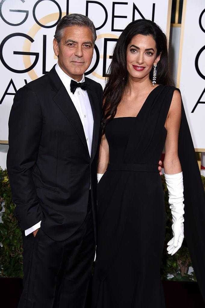 George Clooney and Amal Clooney walk the red carpet at he 72nd Annual Golden Globe Awards on Jan. 11, 2015. (Photo: Steve Granitz/WireImage)