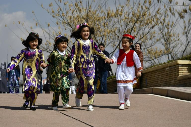 Critics of the Tajikistan government's campaign promoting traditional costume say the dresses are impractical to wear on a daily basis