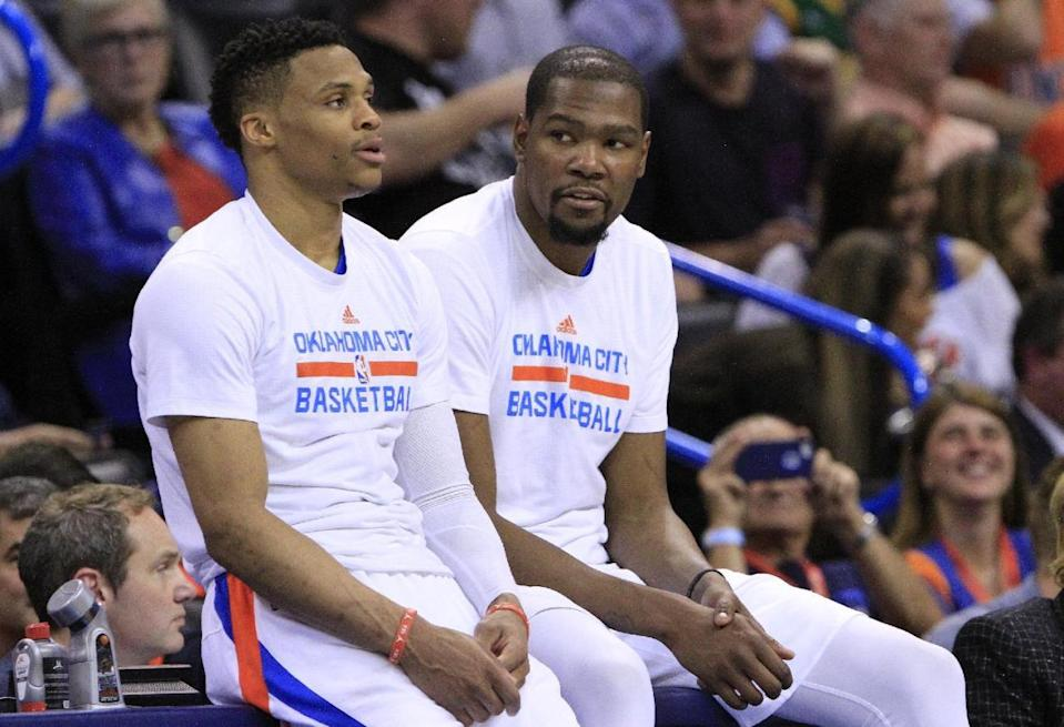 Kevin Durant, right, says he never told Russell Westbrook he was staying in Oklahoma City. (AP)