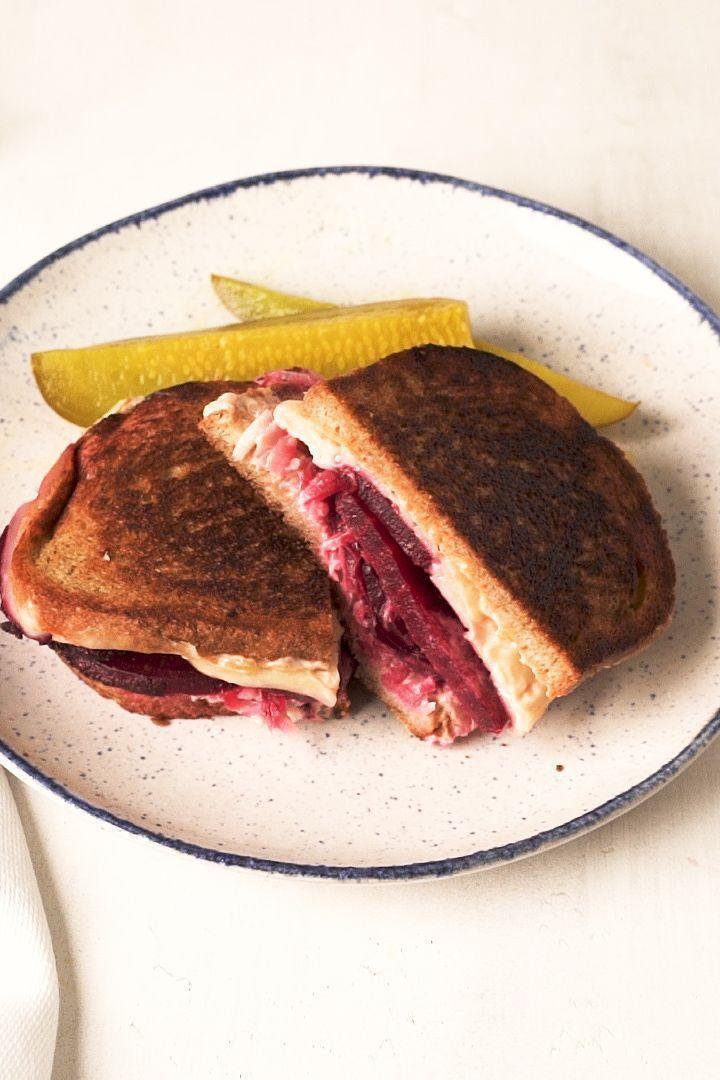 "<p>Flavoured with many of the same spices as <a href=""https://www.delish.com/uk/cooking/recipes/a32360532/classic-reuben-sandwich-recipe/"" rel=""nofollow noopener"" target=""_blank"" data-ylk=""slk:corned beef"" class=""link rapid-noclick-resp"">corned beef</a>, beets take the place of meat in this fun play on the classic deli sandwich. While the beets are roasting, make a quick Russian dressing with ingredients you likely already have in your fridge and pantry—mayo, ketchup, horseradish, and sweet pickle relish.</p><p>Get the <a href=""https://www.delish.com/uk/cooking/recipes/a34548520/vegetarian-beet-reuben-recipe/"" rel=""nofollow noopener"" target=""_blank"" data-ylk=""slk:Vegetarian Beet Reuben Sandwich"" class=""link rapid-noclick-resp"">Vegetarian Beet Reuben Sandwich</a> recipe.</p>"