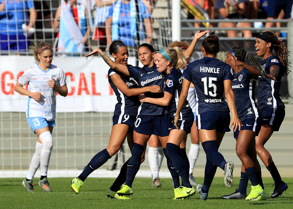 Debinha (center) celebrates after scoring the opening goal in the North Carolina Courage's 4-0 victory over the Chicago Red Stars in the NWSL Championship on Sunday. (Getty)