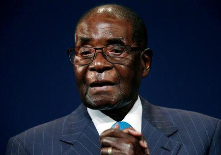 FILE PHOTO - Zimbabwean President Mugabe leaves the stage after participating in a discussion at the World Economic Forum on Africa 2017 meeting in Durban