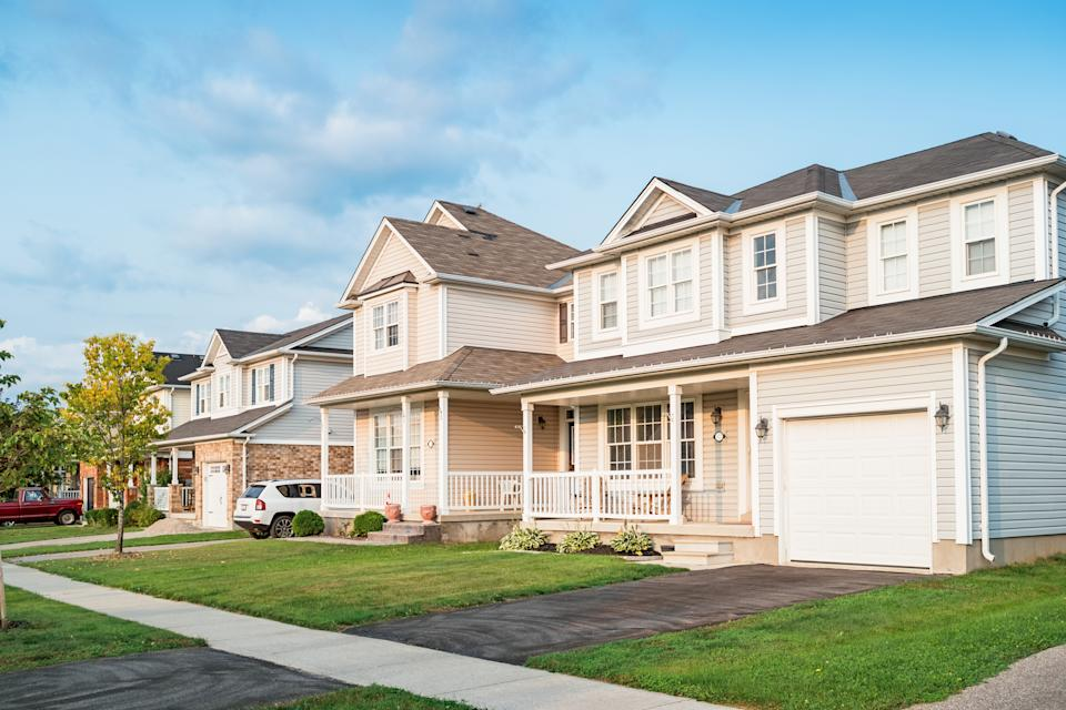row of new homes and front yards in Brantford Ontario Canada.