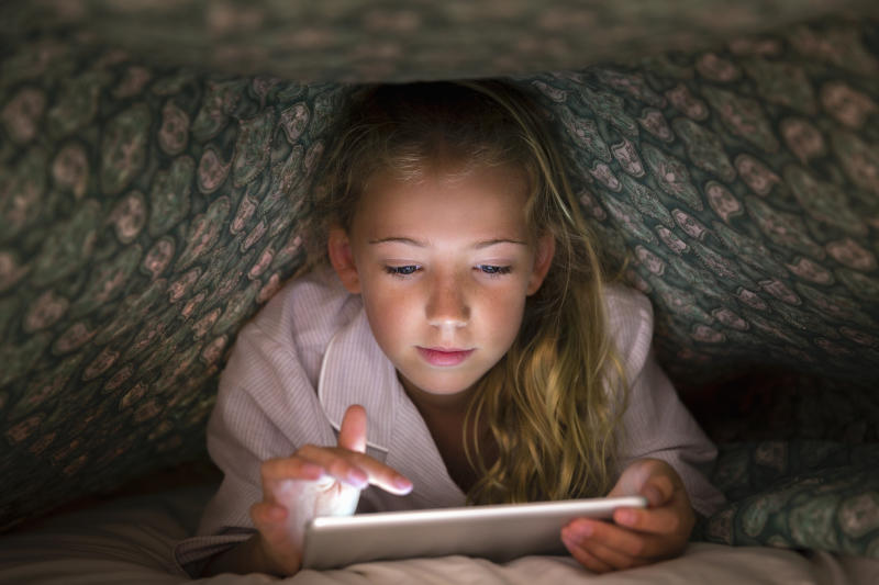 Parents are paying their children to stay off their tablets [Photo: Getty]