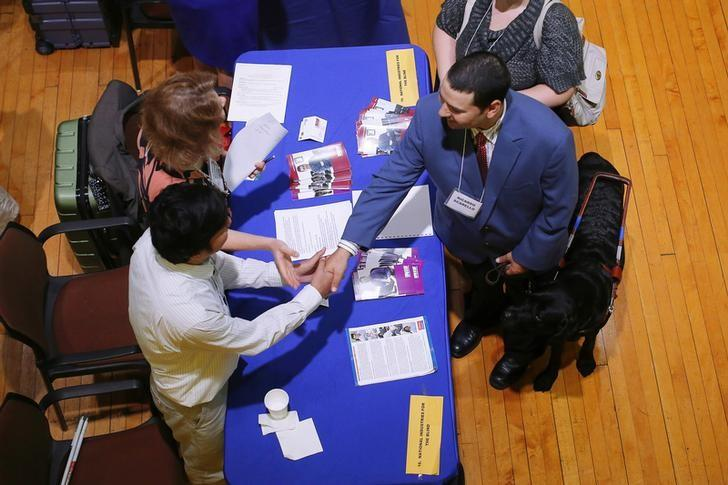 Job seeker Ricardo Scarello talks to representatives from the National Industries for the Blind at the fourth Annual Job Fair for Individuals with Visual Impairments in Cambridge