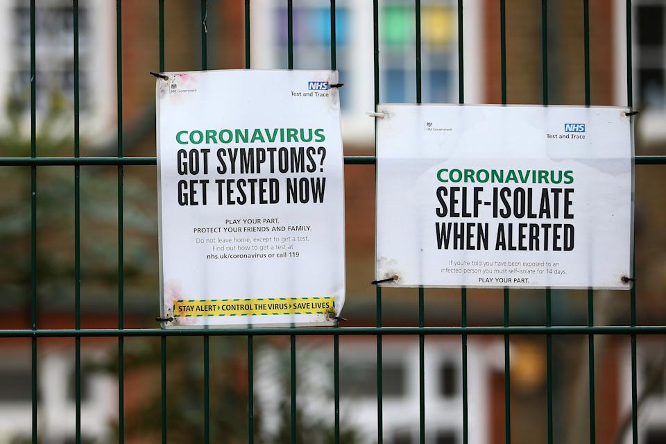 LONDON, ENGLAND - JANUARY 10: NHS Test and Trace notices displayed outside King Solomon Academy in Westminster on January 10, 2021 in London, England. England is expanding rapid