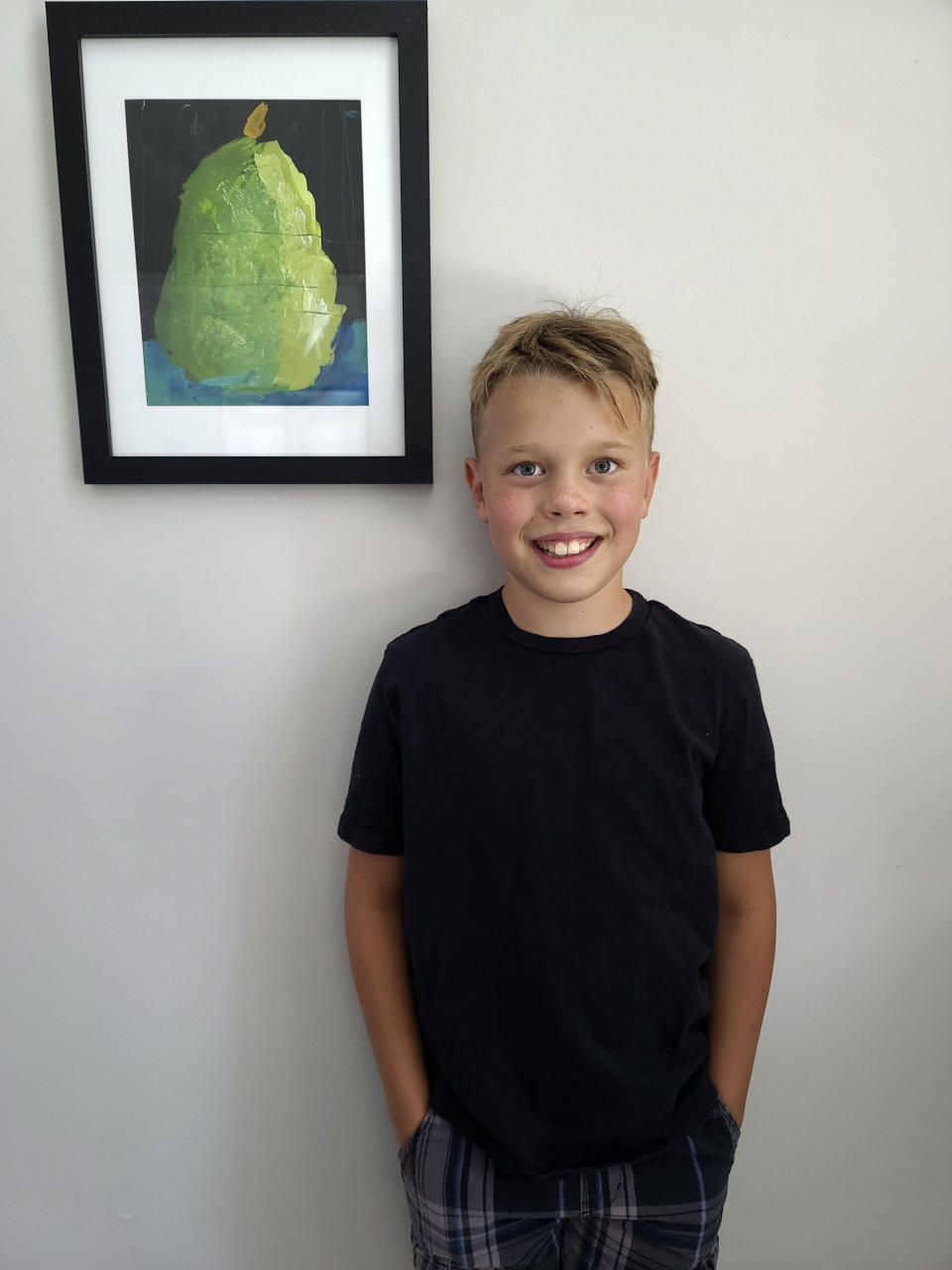 This image released by Elle Anderson shows a portrait of her son Aiden Anderson, 11, in Orlando. Anderson will begin sixth grade at home for two weeks, then happily head out to school in a state that's among the nation's worst hot spots for the virus. (Elle Anderson via AP)