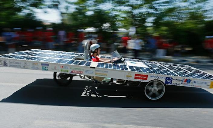 A Cypriot competitor steers his solar car during the Cyprus Institute's solar car challenge in Nicosia on June 23, 2019 (AFP Photo/Matthieu CLAVEL)