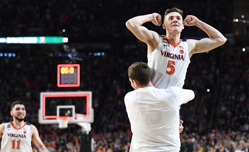 MINNEAPOLIS , MN - APRIL 6: Virginia Cavaliers guard Kyle Guy (5) is hoisted up by  Austin Katstra (45) as time expired on their win over the Auburn Tigers. He made three free throws to win the game with .6. seconds on the clock during semifinal action at U.S. Bank Stadium.  (Photo by Jonathan Newton / The Washington Post via Getty Images)