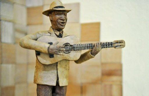 A model of Cuban musician Compay Segundo made out of tobacco leaves by sculptor Janio Nunez at his workshop in Guanabo, a beach town east of Havana. Nunez uses the same sticky leaves and time-honored rolling techniques that go into the famed cigars enjoyed by his subjects, and which was celebrated at last week's 14th annual Havana Festival