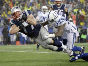 New England Patriots tackle Nate Solder scores against Indianapolis Colts inside linebacker D'Qwell Jackson (52) on a 16-yard touchdown pass from quarterback Tom Brady during the second half of the NFL football AFC Championship game Sunday, Jan. 18, 2015, in Foxborough, Mass. (AP Photo/Matt Slocum)