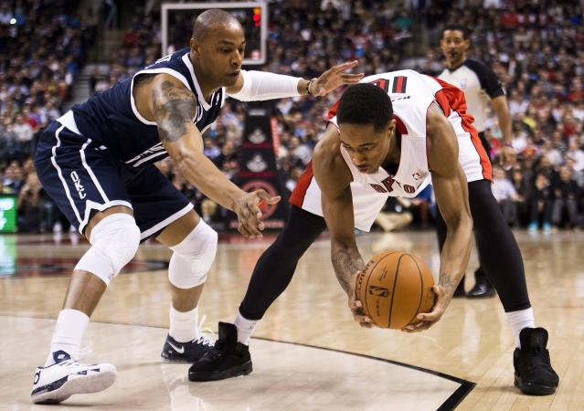 Toronto Raptors forward DeMar DeRozan, right, guards the ball against Oklahoma Thunder forward Caron Butler, left, during the first half of an NBA basketball game in Toronto on Friday, March 21, 2014. (AP Photo/The Canadian Press, Nathan Denette)