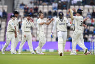 New Zealand's Neil Wagner, fourth left, celebrates with teammates the dismissal of India's Shubman Gill, third right, during the second day of the World Test Championship final cricket match between New Zealand and India, at the Rose Bowl in Southampton, England, Saturday, June 19, 2021. (AP Photo/Ian Walton)