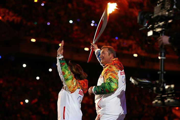 <p>The Olympic flame is lit jointly by former hockey goalie Vladislav Tretiak, who played from 1972 to 1984, and legendary figure skater Irina Rodnina.</p>