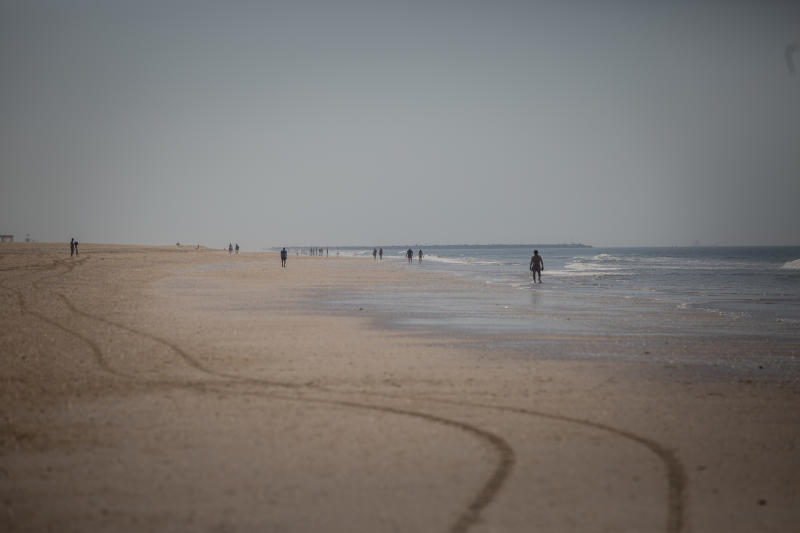 HUELVA, SPAIN - MAY 21: People strolls along the Punta Umbría Beach, open only for walking and practicing sports, during the second week of Phase 1 of reduction of the confinement against the coronavirus on May 21, 2020 in Huelva, Spain. (Photo by Maria José López/ Europa Press via Getty Images) (Photo by Europa Press News/Europa Press via Getty Images)