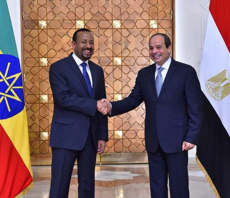 Egyptian President Abdel Fattah al-Sisi (R) shakes hands with Ethiopian Prime Minister Abiy Ahmed at the Ittihadiya presidential palace in Cairo, Egypt, June 10, 2018. in this handout picture courtesy of the Egyptian Presidency. The Egyptian Presidency/Handout via REUTERS