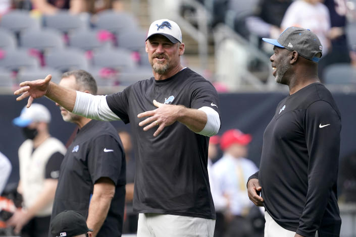 Detroit Lions head coach Dan Campbell, left, talks with Offensive Coordinator Anthony Lynn before an NFL football game against the Chicago Bears Sunday, Oct. 3, 2021, in Chicago. (AP Photo/David Banks)