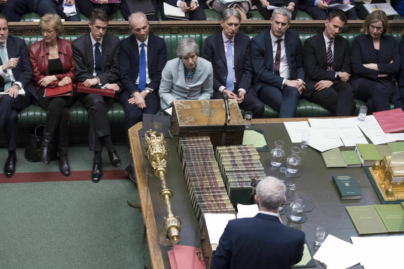 In this handout photo provided by the UK Parliament, Britain's oposition Labour party leader Jeremy Corbyn, front, makes a statement after Prime Minister Theresa May made a statement on Brexit to the House of Commons, London, Monday, March 25, 2019. British Prime Minister Theresa May conceded Monday that Parliament would defeat her twice-rejected Brexit divorce deal again if she put it to a new vote, but said she still hopes to change lawmakers' minds and get the agreement approved. (Jessica Taylor/UK Parliament via AP)