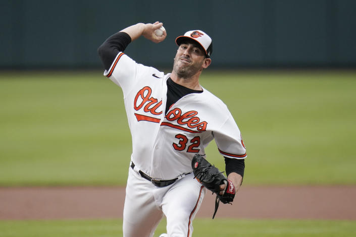 Baltimore Orioles starting pitcher Matt Harvey throws a pitch to the New York Mets during the first inning of a baseball game, Wednesday, June 9, 2021, in Baltimore. (AP Photo/Julio Cortez)