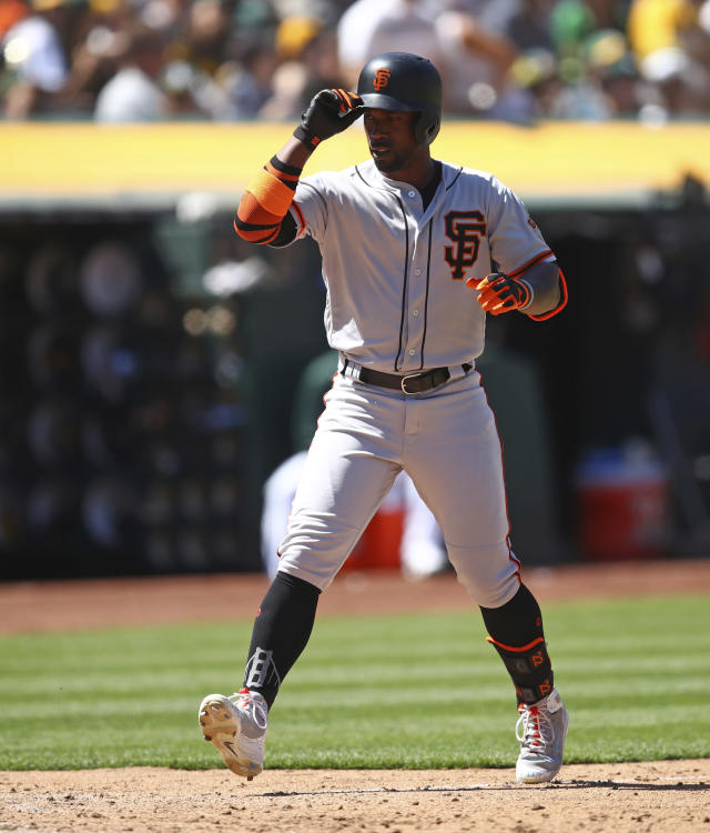 San Francisco Giants' Andrew McCutchen celebrates after hitting a home run off Oakland Athletics' Yusmeiro Petit in the eighth inning of a baseball game Sunday, July 22, 2018, in Oakland, Calif. (AP Photo/Ben Margot)