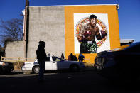 A new Mural Arts Philadelphia painting honoring Joe Frazier on the 50th anniversary of the boxer's World Heavyweight championship bout against Muhammad Ali, in shown on the side of a building in Philadelphia, Monday, March 8, 2021. (AP Photo/Matt Rourke)