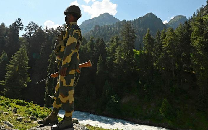 An Indian Border Security Force soldier guards a highway leading towards Leh - TAUSEEF MUSTAFA/AFP via Getty Images