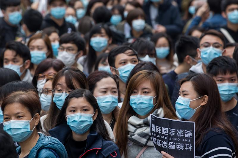 Medical workers wearing protective masks gather during a protest outside the Hospital Authority's head office in Hong Kong, China, on Feb. 4, 2020.   Paul Yeung/Bloomberg via Getty Images