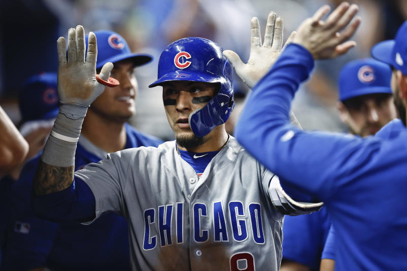 Chicago Cubs' Javier Baez (9) celebrates in the dugout after his solo home run during the eighth inning of the team's baseball game against the Miami Marlins on Wednesday, April 17, 2019, in Miami. (AP Photo/Brynn Anderson)