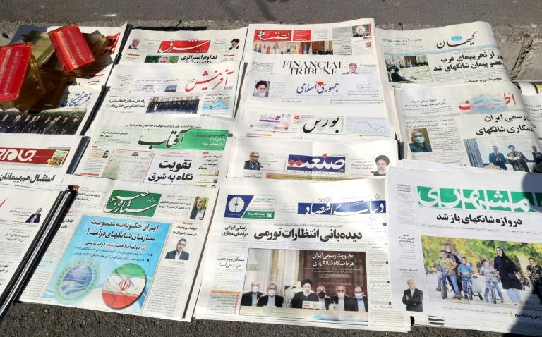Conservative and reform newspapers in Iran showed rare unity in welcoming results of the Shanghai Cooperation Organisation conference (AFP/ATTA KENARE)