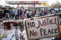 Demonstrators gather for a solidarity rally in memory of the deceased George Floyd and Daunte Wright outside Cup Foods, Sunday, April 18, 2021, in Minneapolis. (AP Photo/John Minchillo)