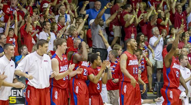 The Dayton bench, along with their fans, celebrate as time counts down on the game clock in the second half of an NCAA college basketball game against Gonzaga at the Maui Invitational on Monday, Nov. 25, 2013, in Lahaina, Hawaii. Dayton upset Gonzaga 84-79. (AP Photo/Eugene Tanner)