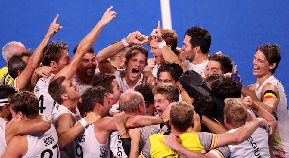 Belgium celebrate victory in the men's gold medal match in the hockey.