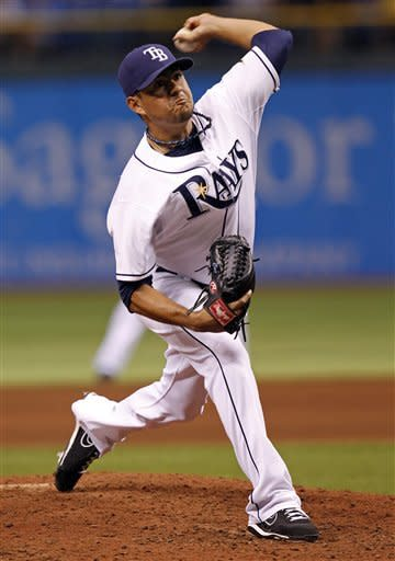 Tampa Bay Rays relief pitcher Cesar Ramos throws during the fifth inning of a baseball game against the Seattle Mariners Saturday, July 21, 2012, in St. Petersburg, Fla. (AP Photo/Mike Carlson)