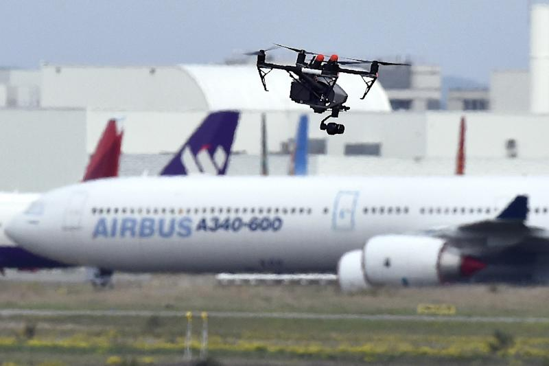 More than a nuisance, drones flying by airports pose a real danger as they could cause a deadly accident if they get sucked into an aircraft's engine (AFP Photo/PASCAL PAVANI)