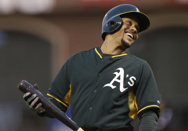 Oakland Athletics' Coco Crisp laughs after striking out against San Francisco Giants pitcher Tim Hudson during the first inning of an exhibition baseball game in San Francisco, Thursday, March 27, 2014. (AP Photo/Jeff Chiu)