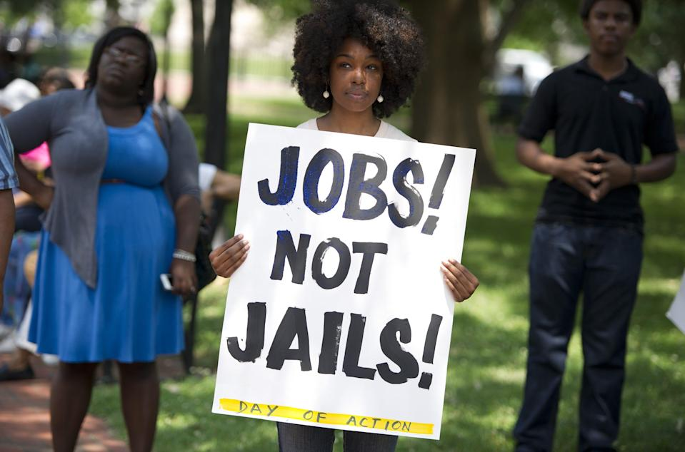 A demonstrator holds a sign during a rally on June 17, 2013. Saul LOEB/AFP/Getty Images