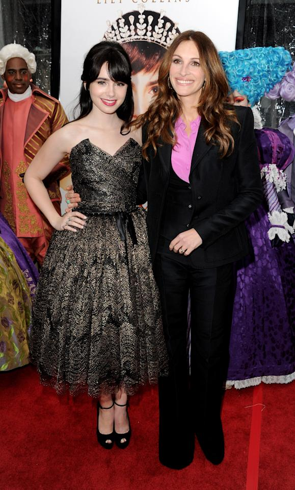 "LOS ANGELES, CA - MARCH 17:  Actors Lily Collins (L) and Julia Roberts arrive at the premiere of Relativity Media's ""Mirror Mirror"" at the Chinese Theater on March 17, 2012 in Los Angeles, California.  (Photo by Kevin Winter/Getty Images)"
