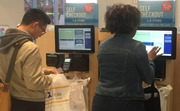 Several customers complained that when recently visiting a Shoppers Drug Mart store, they were told they must use self-checkout — unless they paid with cash. The chain's parent company says its policy is that customers should always have the choice to pay at the cash. (CBC - image credit)