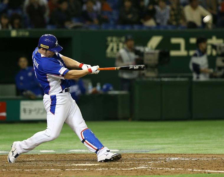 South Korean slugger Park Byeong-Ho hits a three-run homer during the final of the Premier 12 baseball tournament in Tokyo on November 21, 2015