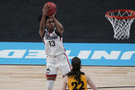 UConn guard Christyn Williams (13) shoots over Iowa guard Caitlin Clark (22) during the first half of a college basketball game in the Sweet Sixteen round of the women's NCAA tournament at the Alamodome in San Antonio, Saturday, March 27, 2021. (AP Photo/Eric Gay)