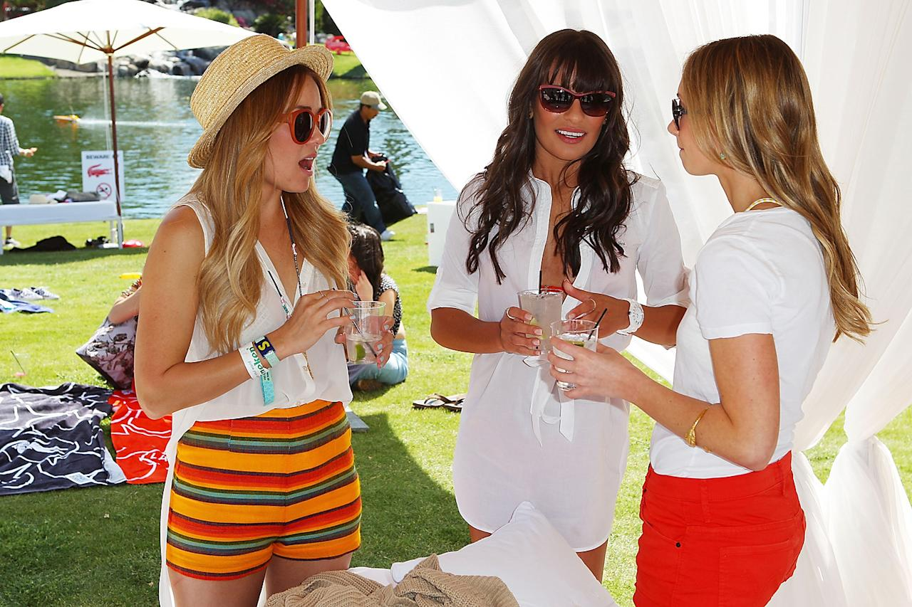 Lauren Conrad, Lea Michelle and Teresa Palmer attend the Lacoste pool party during the Coachella Music Festival in Thermal, California.
