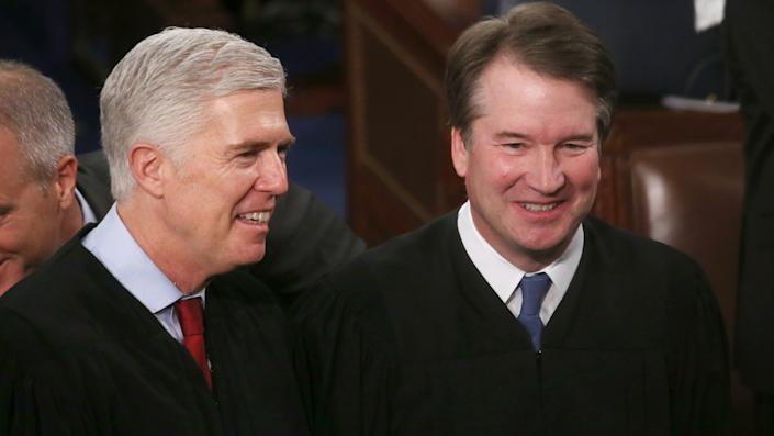 Supreme Court Justices Neil Gorsuch, left, and Brett Kavanaugh attend the State of the Union address in the U.S. House of Representatives in February 2020.