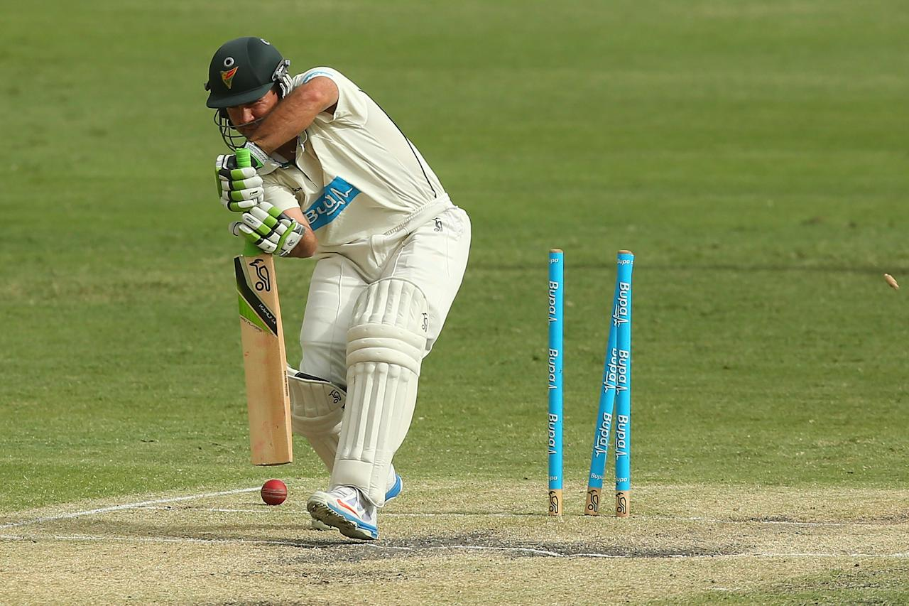 BRISBANE, AUSTRALIA - MARCH 09:  Ricky Ponting of the Tigers is bowled out for a duck by Nathan Reardon of the Bulls during day three of the Sheffield Shield match between the Queensland Bulls and the Tasmanian Tigers at The Gabba on March 9, 2013 in Brisbane, Australia.  (Photo by Chris Hyde/Getty Images)