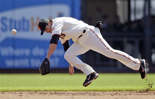 San Francisco Giants second baseman Ryan Theriot dives and misses a ground ball hit by Oakland Athletics' Kila Ka'aihue during the second inning of their exhibition baseball game in San Francisco, Wednesday, April 4, 2012. (AP Photo/Eric Risberg)