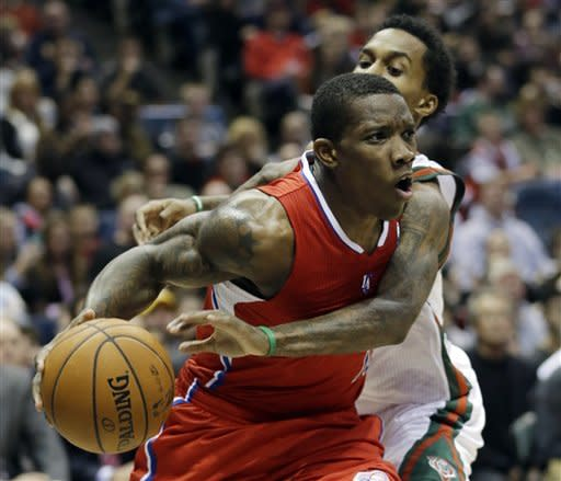 Los Angeles Clippers' Eric Bledsoe is fouled as he tries to drive past Milwaukee Bucks' Brandon Jennings during the first half of an NBA basketball game Saturday, Dec. 15, 2012, in Milwaukee. (AP Photo/Morry Gash)
