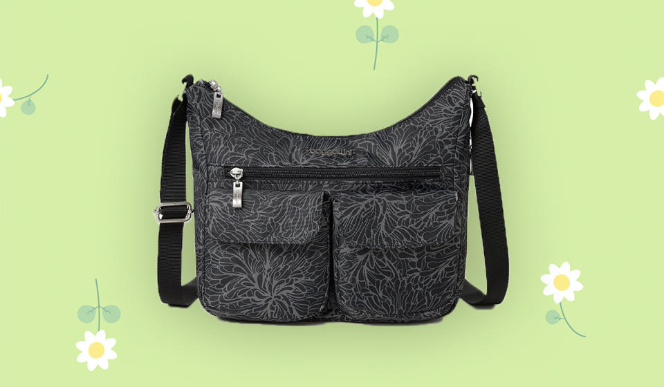 Check out this gorgeous floral print! It's called Midnight Blossom, and it's the best travel buddy you'll ever have. (Photo: QVC)