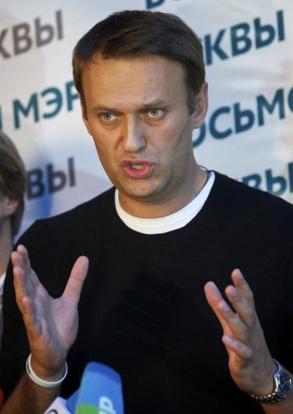 Russian opposition leader Alexei Navalny gestures as he speaks to the media at his headquarters in Moscow, Russia, Sunday, Sept. 8, 2013. Two exit polls in Moscow's mayoral election are predicting a stronger showing than expected for opposition leader Alexei Navalny. Sunday's mayoral election is a potentially pivotal contest that has energized the small opposition in ways that could pose a risk to the Kremlin in the days and years ahead. (AP Photo/Alexander Zemlianichenko)